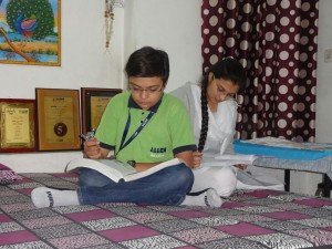 Jeevesh studying Biology books with his sister